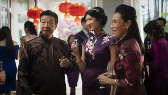 """Characters in """"Kung Fu"""" dressed for a Chinese wedding event."""
