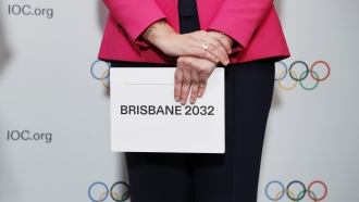 Woman holding the queue card after Brisbane was announced as 2032 Summer Olympics host.