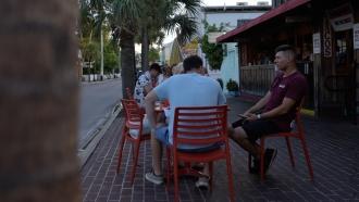 Customers sit outside