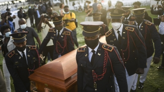 Police carry the coffin of slain Haitian President Jovenel Moise at the start of the funeral