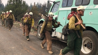 Crews Make Progress On Largest Wildfire Burning In The U.S.