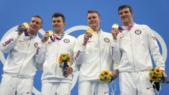 United States men's 4x100m freestyle relay team of Caeleb Dressel, Blake Pieroni, Bowen Beck and Zach Apple, celebrate.