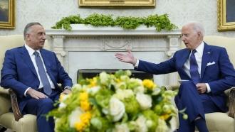 President Joe Biden speaks with Iraqi Prime Minister Mustafa al-Kadhimi in the Oval Office