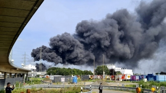 A dark cloud of smoke rises above the chemical park in Leverkusen, Germany,