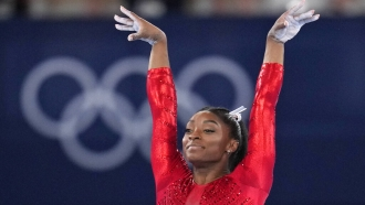 Simone Biles, of the United States, performs on the vault