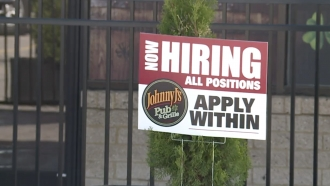 Hiring sign in the yard.