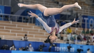 Sunisa Lee, of the United States, performs on the balance beam during the artistic gymnastics women's all-around final.