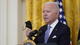 President Joe Biden holding a face mask.
