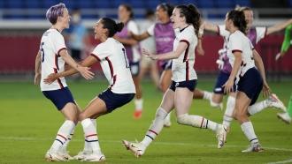 United States' Megan Rapinoe, left, celebrates with teammates after scoring the winning goal.