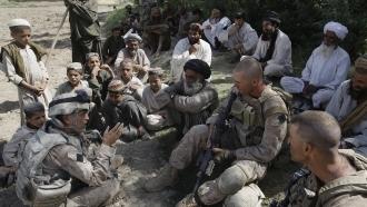 U.S. Marines speaking with Afghan villagers.
