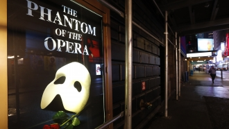 """A poster advertising """"The Phantom of the Opera"""" is displayed"""