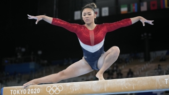 Sunisa Lee performs on the balance beam during the artistic gymnastics women's final at the Tokyo Olympics