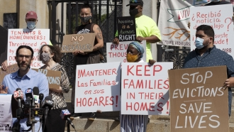 People from a coalition of housing justice groups protesting evictions.