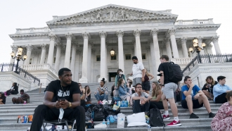 Supporters of Rep. Cori Bush, D-Mo., camp with her outside the U.S. Capitol, in Washington