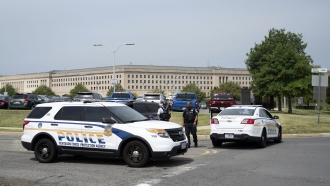 Police block off an entrance to the Pentagon following reports of multiple gunshots.