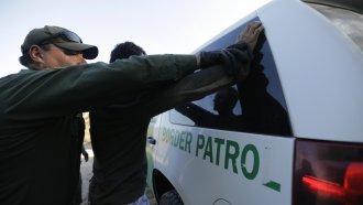 A U.S. Border Patrol agent apprehends a migrant