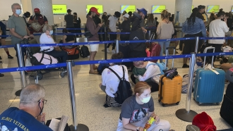 Passengers line up inside the Spirit Airlines terminal at Los Angeles International Airport in Los Angeles.