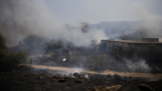 Fields burn following a hit by a rocket fired from Lebanon into Israeli territory