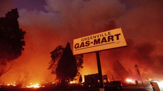 Flames consume buildings as the Dixie Fire tears through the Greenville community of Plumas County
