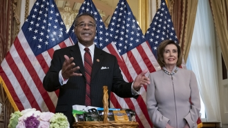 Rep. Emmanuel Cleaver of Missouri stands by Speaker of the House Nancy Pelosi.