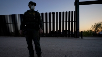 A U.S. Customs and Border Protection agent near the U.S.-Mexico border wall in Texas.
