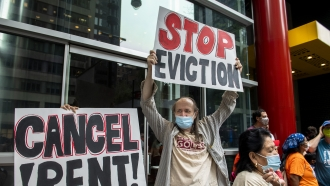 Housing advocates protest outside Governor Andrew Cuomo's office on the eviction moratorium