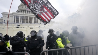 U.S. Capitol Police officers hold off rioters.