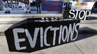 tenants' rights advocates demonstrate in front of the Edward W. Brooke Courthouse in Boston.