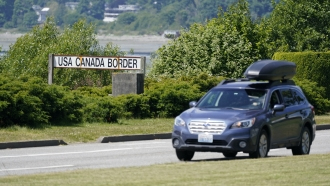 A car heads into the U.S. from Canada at the Peace Arch border crossing in Blaine, Wash.