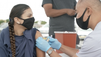 Jewel Ontiveros, 17, gets her first dose of an MRNA COVID-19 Vaccine.