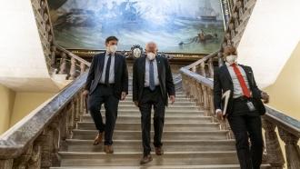 Senate Budget Committee Chairman Bernie Sanders, I-Vt., center, walks towards the Senate floor.