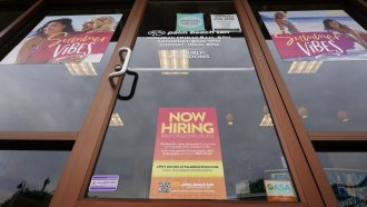 A Now Hiring sign at a business in Richmond, Va., Wednesday, June 2, 2021.