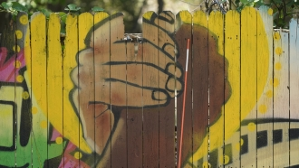 A mural on a fence is displayed at United Fort Worth,