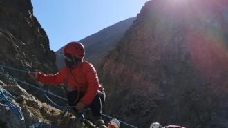 An Afghan woman climbs