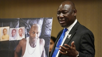 Attorney Ben Crump holds up a picture of Byron Williams, who died in Las Vegas police custody.