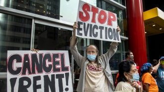 Housing advocates protest outside Gov. Andrew Cuomo's office on the eviction moratorium in New York.