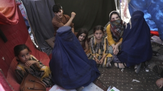Displaced women and children in a camp in Kabul, Afghanistan.