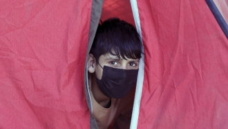 A displaced Afghan boy from northern provinces, who fled his home due to fighting between the Taliban and Afghanistan