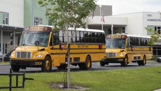 School buses line up for students outside Audubon Park Elementary School.