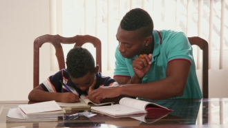 A father helping his son with school work