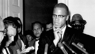 Civil rights leader Malcolm X speaks to reporters in Washington, D.C.