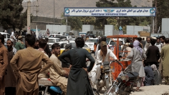 Crowds outside the airport in Kabul