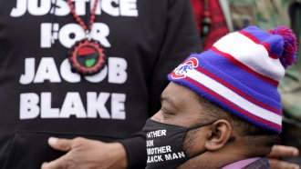 Jacob Blake Jr. listens to a speech during a Get Out The Vote rally in Chicago