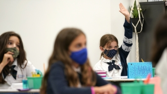 Children in a Florida school wearing face masks to guard against COVID-19 infections.