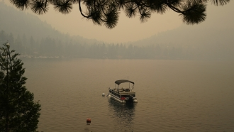 Smoke from the Caldor Fire shrouds Fallen Leaf Lake near South Lake Tahoe, California