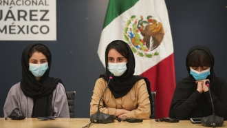 Members of the Afghan all-girls robotics team attend a press conference after arriving in Mexico