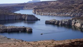 A boat cruises along Lake Powell