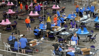 Maricopa County ballots cast in the 2020 general election are examined and recounted in Phoenix, Arizona.
