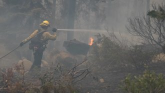 Firefighters battle the Caldor Fire one small blaze at a time.