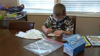 Child writes on masks